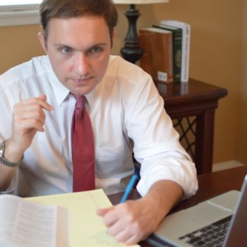 Personal Injury Attorney Donald D'Aunoy Jr. at his desk