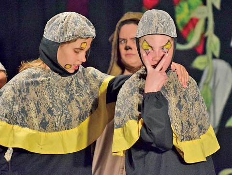 Kaa (Tapanga Townsend and Maggie Boehm) promises to keep an eye on things in a scene from the Davidson School/Missoula Children's Theatre production of The Jungle Book.