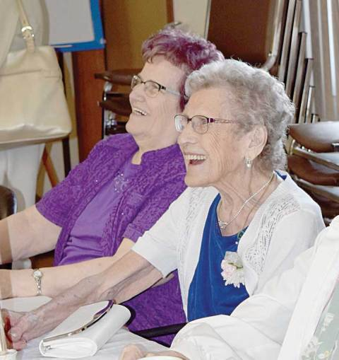 Paula Kenny chats with a guest during a party in honour of her 100th birthday on June 4. Seen at her left is her daughter Marlene Chanski.