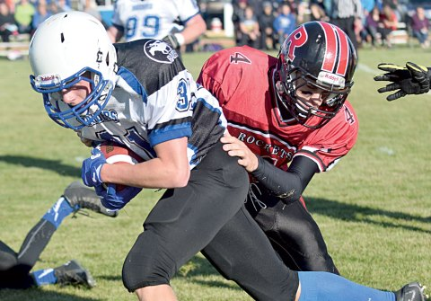 Davidson's Addison Ouellette protects the ball from an Assiniboia attack during a senior football game on Sept. 9.