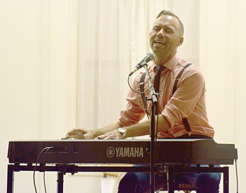 Singer-songwriter Jeffery Straker performs during a concert at the Elbow Civic Centre on Sept. 3.