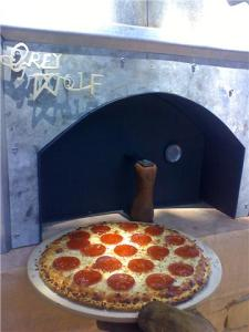 """The first pizza produced from the oven, kicking off Wine Fest Weekend in Paso Robles, Ca."""
