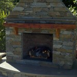 """The wood mantel looks great w/ the rock work."""
