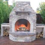 Custom rock fire place with Culture Stone and wood storage boxes.