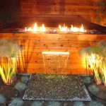 Custom fire pit with Fire Crystals, and water feature within Spa's exterior.