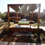 Custom contemporary outdoor day and bench area, with water feature.