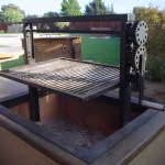 Features a steel frame high heat painted with a stainless steel grill grate. This grill has 2 gears & ratcheting system.