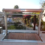 Custom Sant Maria BBQ. Constructed out of Stainless Steel & Copper. Both the Rottisserie and Grill Grates are removable which lift and lower witht a turn of the wheel.