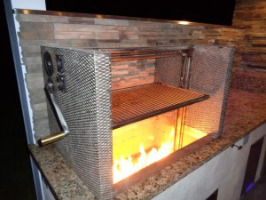 Features Fabricated Stainless Steel Expanded Metal Panels around the grill filled with lava rock. Machined parts, gears, with stainless steel grill grates and hardware.