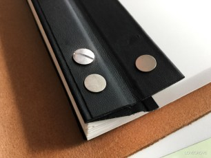 Binding panel open. Shows the built-in magnets to access the pillar and posts.