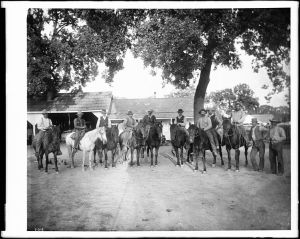 Cowboys_on_horseback_at_a_northern_California_cattle_ranch,_ca.1897-1900_(CHS-2019)