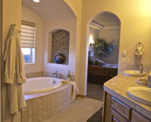 tall sinks arched walls master bathroom