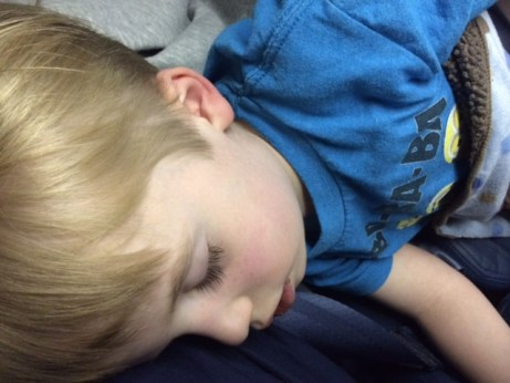 My son sleeping on my lap on the airplane