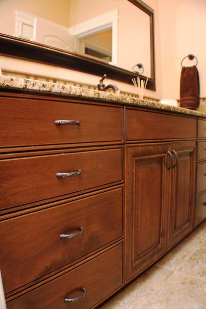 Custom bathroom cabinets made from Alder with a walnut finish. Designed, built and installed for a private residence located in Kennewick, WA by Legacy Mill & Cabinet. Visit our showrooms in Richland, WA and North Salt Lake, UT.