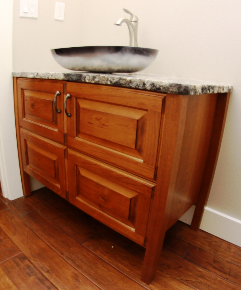 Free standing bathroom vanity made from cherry wood. Custom designed, built and installed for a private residence in Kennewick, WA by Legacy Mill & Cabinet.