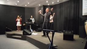 Andrew worshiping