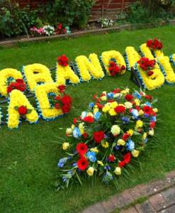 Named-Letter-tribute---Yellow-Flowers-with-White-border