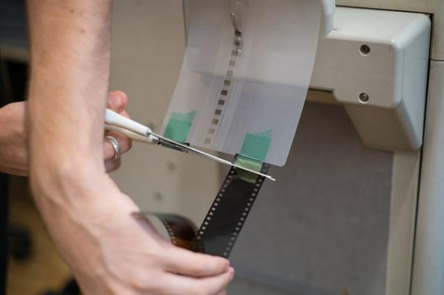 Using scissors to cut film