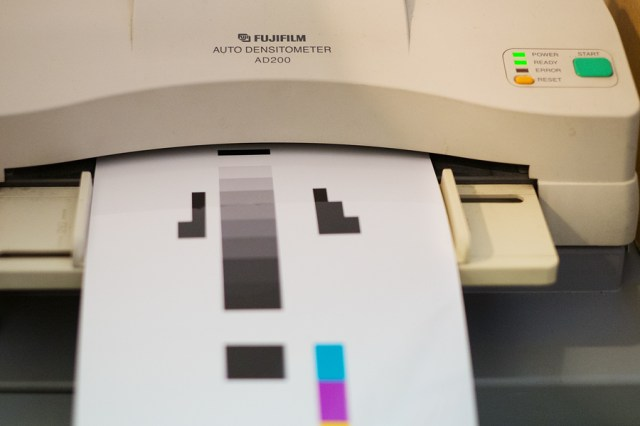 A densitometer reading photo paper