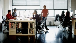 Coworkers at workstations in high tech office