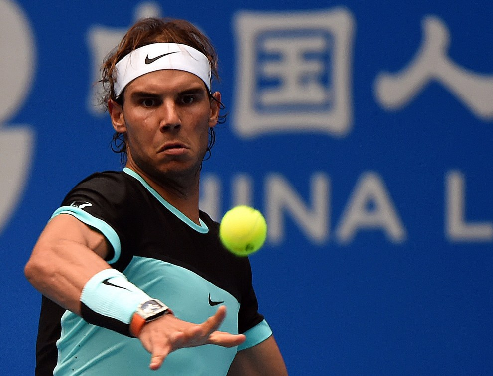 Rafael Nadal of Spain hits a return against Wu Di of China during their first round men's singles match at the China Open tennis tournament in Beijing on October 6, 2015.         AFP PHOTO / GOH CHAI HIN