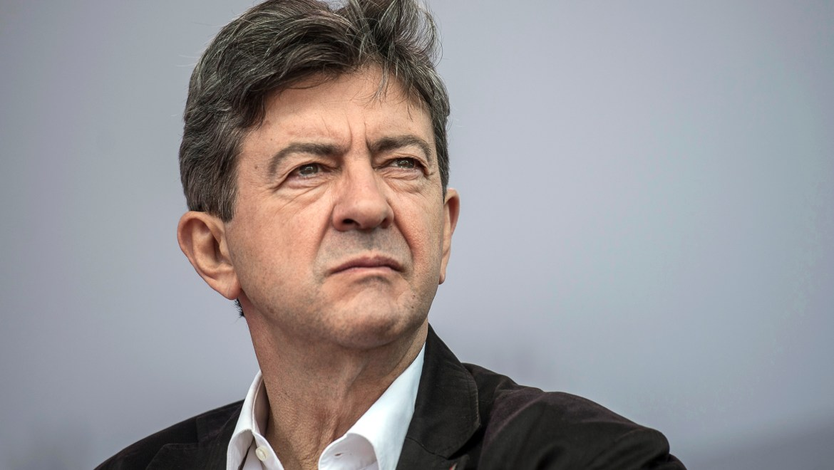 """French far-left leader Jean-Luc Melenchon looks on, during the closing meeting of the """"Universite d'ete Remue-Meninges"""", the summer congress of the Left Party (Parti de Gauche) held in the southeastern French city of Saint-Martin-d'Heres, near Grenoble, on August 26, 2012. AFP PHOTO / JEFF PACHOUD"""