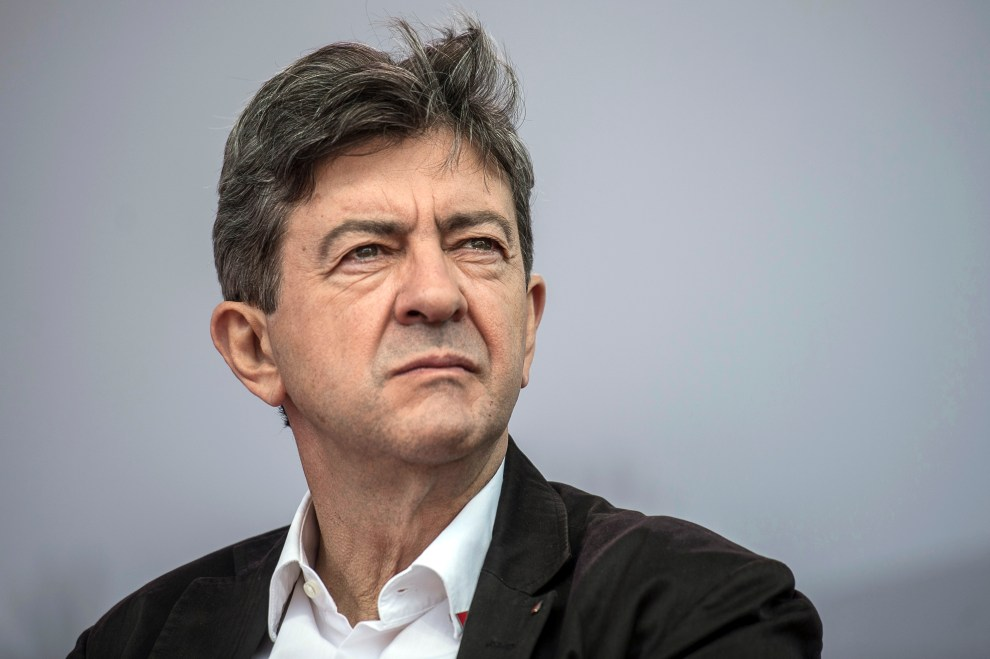 "French far-left leader Jean-Luc Melenchon looks on, during the closing meeting of the ""Universite d'ete Remue-Meninges"", the summer congress of the Left Party (Parti de Gauche) held in the southeastern French city of Saint-Martin-d'Heres, near Grenoble, on August 26, 2012. AFP PHOTO / JEFF PACHOUD"