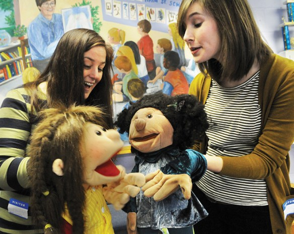 Sexual Assault Support Services educator Emily Murphy, left, holds puppet Lene and interacts with puppet Gwen, held by SASS educator Rhiannon Duke, who is also part of the Americore Victim Assistance Program. The educators use the puppets to demonstrate how they talk to kids in elementary schools about body safety through their prevention education program. Deb Cram/dcram@seacoastonline.com