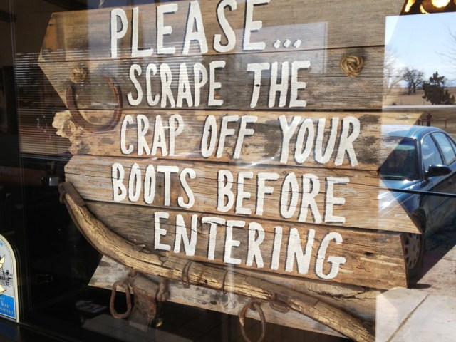 Sign at the door of TJ's Cafe in Newell, SD.  Bear in mind this is sheep country.