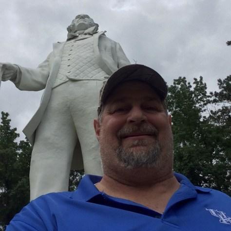 Sumoflam with Big Sam towering behind him