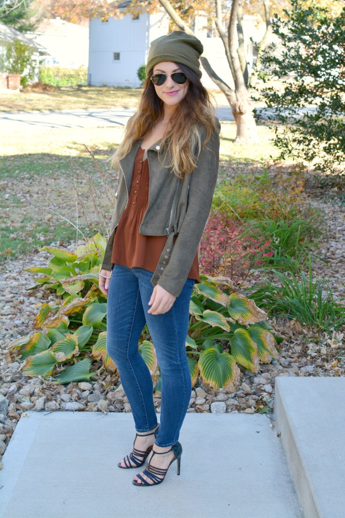 Ashley from LSR in an olive green beanie, olive green suede motorcycle jacket, an Express tank, and Gap jeans.