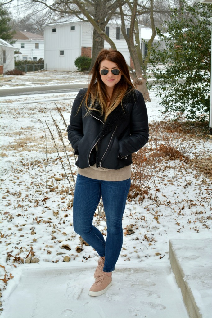 Ashley from LSR in rose quartz sneakers and a shearling moto jacket