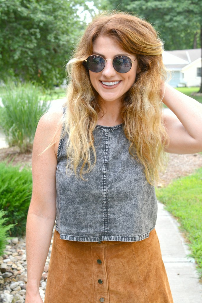 Ashley from LSR in an acid wash crop top and round sunglasses