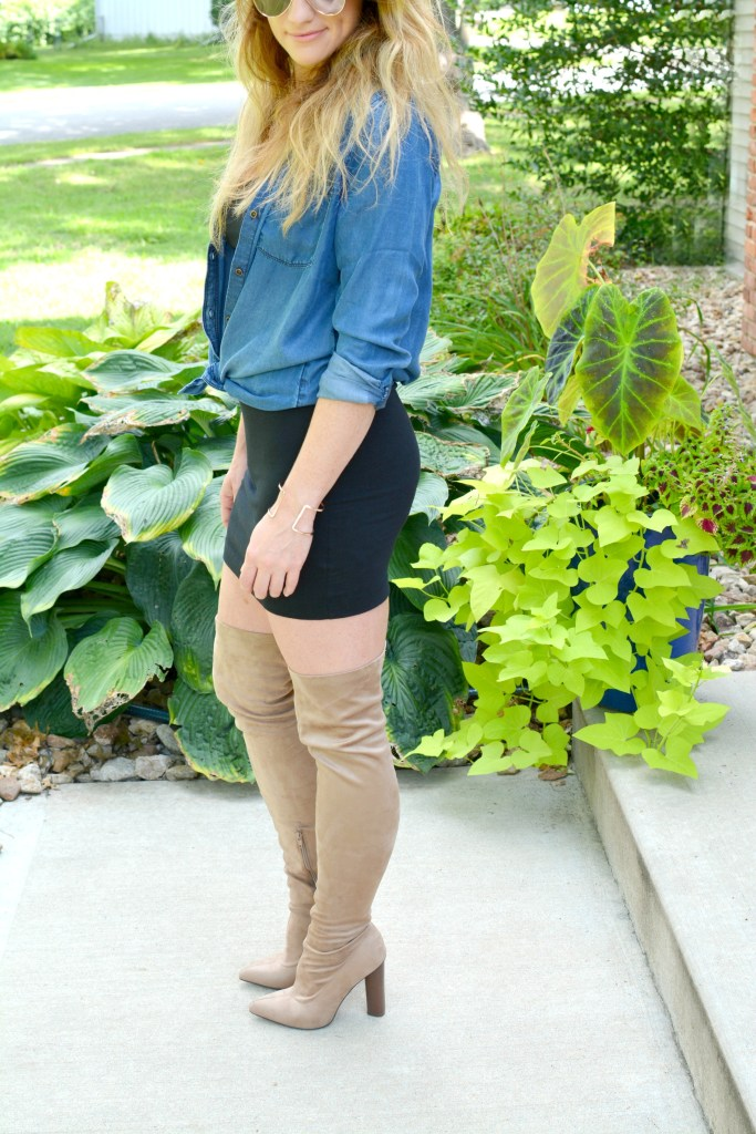 Ashley from LSR in a black t-shirt dress, nude suede thigh high boots, and a chambray shirt
