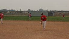 Jeff Schwarz warming up before the game at a fundraising tournament in Coaldale.