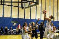 Fifth-year Lethbridge College Kodiaks forward Amy Arbon flys above team-mates and opponents from the Briercrest College Clippers Friday night.