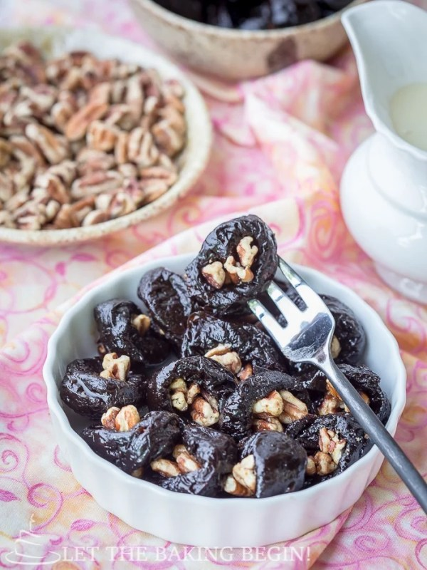 Walnut stuffed prunes are a simple, delectable dessert idea that is as tasty as it is good for you. Drench it in condensed milk for the full experience. By LetTheBakingBeginBlog.com
