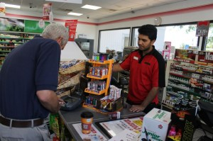 A customer makes a purchase at the 7-Eleven that sold a winning lottery ticket.  Credit: Tom Sofield/LevittownNow.com