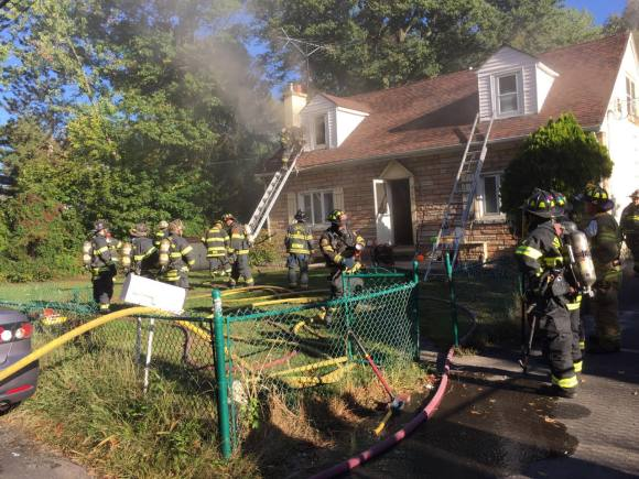 Firefighters Rescue Pets From Burning House