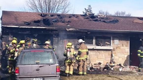 UPDATED: Firefighter Hurt, Dog Killed In Blaze