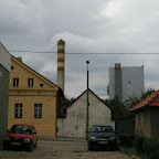 Large power station behind old buildings in Chorzów Stary.