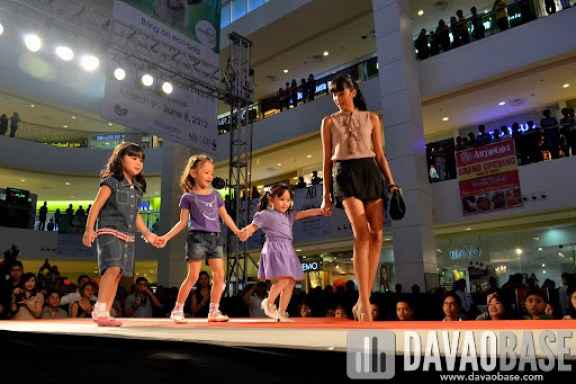 Female model fetches the 3 girls from the runway, during the Style Origin Fashion Show at Abreeza