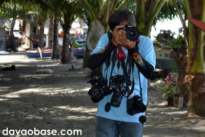 An employee from Sarangani Provincial Hall gamely obliges to take our pictures using all of our cameras! Taken at the Pawikan Nesting Sanctuary in Maitum, Sarangani.