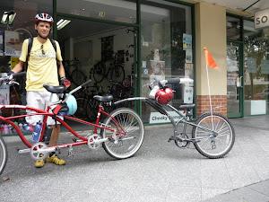 Cruiser tandem and trailer bike for family transport.