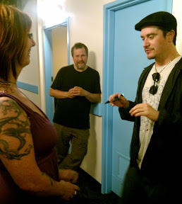 Mike Patton, uncomfortably, prepares to autograph his first boob.  Billy seems to enjoy watching Mike squirm.