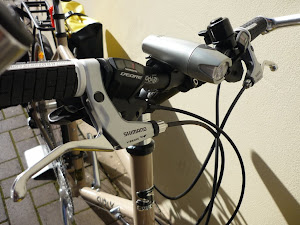 alivio brake levers work great, deore shifters have lost their round design but still good quality
