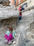 The girls ignore the sign, hop the fence and climb down the back way of Trevi Fountain.