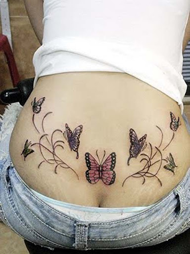 girls tattoo on lower back