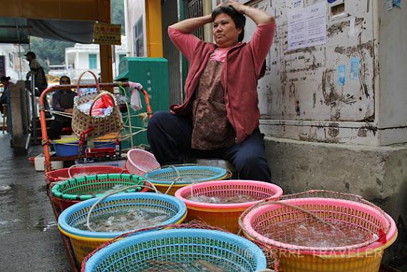 hong kong fish seller, lantau fishing village, tai o fishing village lantau island, fishing villages in asia, lantau island attractions, fishing village in hong kong