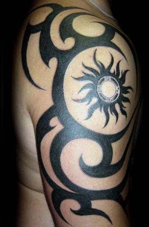 sun designs tattoos tribal
